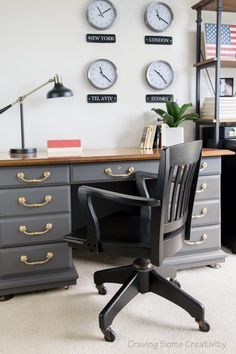 Masculine home Office with patriotic decor. World Wall clocks, Antique desk in Telegram gray, and shelves with so much to see. Love this sophisticated, industrial office!