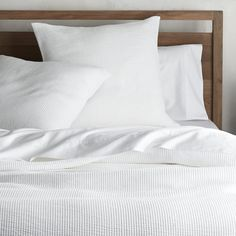 "Classic white bed linens go ultra soft, woven of extra fine cotton yarns on a jacquard loom for a hint of texture. A stonewash finish contributes even more softness to these gorgeous, layer-friendly textiles. <a href=""/bed-and-bath/bed-pillows/1"">Bed Pillows</a> also available.<br /><br /><NEWTAG/><ul><li>100% cotton</li><li>Jacquard woven</li><li>Sham has back overlap closure</li><li>Machine wash cold, tumble dry low; warm iron as needed</li><li>Made in Portugal</li></ul><br />"