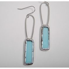 Light blue recycled glass bottles were cut and shaped for these pretty and fun handmade earrings for women.  The edges have been finished nicely with lead free solder and they dangle nicely from surgical steel ear wires.