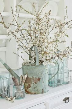 Love the old watering can with flowers