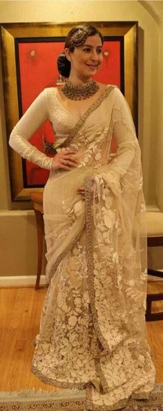 More focus on the cream..but simply lovely..the blouse cut is beautiful...overall fantastic get up..Sabyasachi