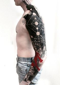 Man I love this sleeve. The overall design in phenomenal. The black ink is bold and strong. I also love the vibrant splash of red. I'm hesitant to call this a trash polka tattoo but love it either way. #CuratedTattoos