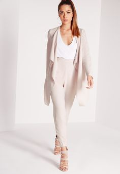 For a smart, polished feel to your look, you need this waterfall jacket. In on point grey, this little beaut is lightweight must have! With elasticated waist detail and in a waterfall style, wear with the matching trousers, a blouse and bar...