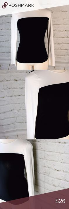 """Anne Klein Black/White Color-Block Blouse ABOUT ITEM ◐ Anne Klein Black/White Colorblock Top. ◐ Women's size Small. ◐ Great for casual or career wear! ◐ Garment is pre-owned; good condition. ◐ Country of Manufacture: Cambodia.  MATERIALS USED ◐ 58% Cotton ◐ 37% Modal ◐ 5% Spandex  MEASUREMENTS ◐ Shoulder to Shoulder: 15 ◐ Bust: 30"""" ◐ Total Length: 24"""" Anne Klein Tops Blouses"""