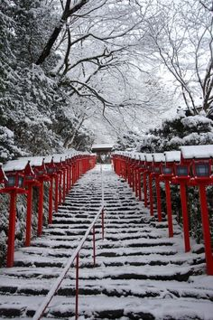 snowy stairs with red lanterns in Kyoto, Japan