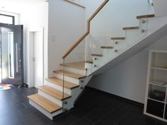 Stairs, banisters made of glass, modern stairs, individual stairs, reversible . Flooring For Stairs, Concrete Stairs, Rustic Stairs, Modern Stairs, Stairs In Kitchen, Wrought Iron Stair Railing, Stairway Decorating, Tiny House Stairs, Round Stairs