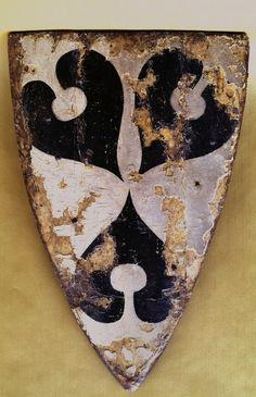 Schild mit Wappen der von Nordeck zu Rabenau, 1250-1300. In Silber drei schwarze Seeblätter, im Dreipaß angeordnet (Museum für Kulturgeschichte im Landgrafenschloß Marburg). -- See also at: http://www.myarmoury.com/feature_shield.html
