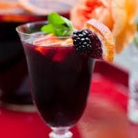 You know it is summer when sangria is on the menu. What's inside? 1 oz blackcurrant liquor, sparkling rose wine, squeeze of lemon, poured on ice and garnished with mint and blackberry!