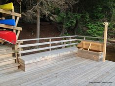 A lakefront cedar dock with storage built into seating for paddles and life jackets.
