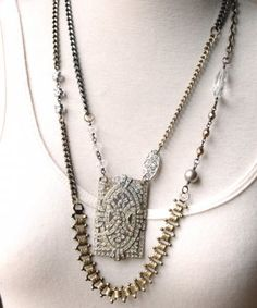 Vintage pendant of rhinestones, mixed metal chains and hand wrapped crystals. Length: 23""