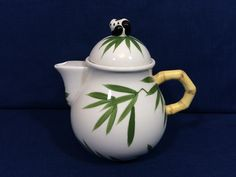 small teapot with bamboo leaf decoration, bamboo handle, panda knob, short spout, ceramic