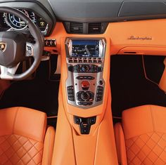 An Orange leather interior from a Lamborghini Aventador painted in Grigio Adamas   Photo taken by: @tedskillet on Instagram (He is also the owner of the car)