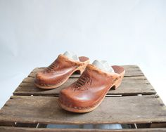 Vintage 70s Wood Clogs / Tribal Pattern / 1970s Leather Clogs / Shoes 7. GingerRootVintage via Etsy. Does someone have a smaller foot than me? These are great.