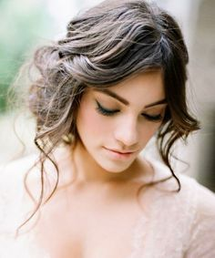 You can put away that veil, because you're going to want everyone to see your seriously stunning wedding day hair