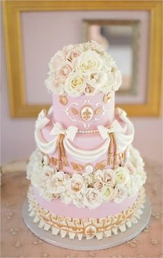 Pink princess wedding cake  All the pinkaholics lolita princess out there would want this sweet looking cake romantically decorated with ivory and pale pink roses and fondant drapes, finished off with some Victorian inspired ornaments.  Beautifully captured by Jennifer Skog