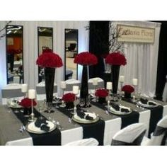 Red, Black and White Wedding Theme: minus the tall red flowers and add candles to the tables.