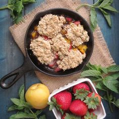 Cobbler for breakfast! The base is a refreshing blend of strawberry, apricot, and mint, and the topping is actually baked oatmeal. #vegan