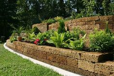 Can't wait until our new water line is finally installed and the dirt back in place, so we can finally landscape the front of our house like this...retaining walls are easy and pretty!