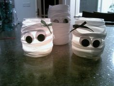 Halloween mummies out of baby food jars and strips of cloth. Holds a tea light perfectly!