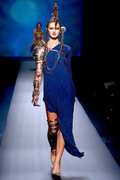 She's even got studded metal shin guards!   (Jean Paul Gaultier Couture SS '10)