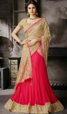 Be a show topper wearing this beige and red jacquard, net and satin lehenga saree. The incredible saree creates a dramatic canvas with terrific resham work. #NewDesignLehengaSaree