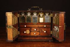 An 18th Century Mahogany Apothecary Cabinet bearing a paper label 'Smart, Chemist & Druggist, St Martins Court, Near Leicester Square, London'. Containing nine glass bottles, the drawers having various containers and glass implements. 10 ins x 11½ ins x 7½ ins (25.5 cms x 29 cms x 19 cms).