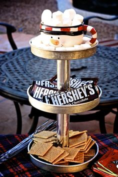 I like the idea of using a 3 Tiered stand to display food, like smores ingredients.