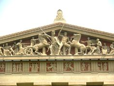 Ancient Greek Architecture. Contest between Athena and Poseidon is shown on the Nashville Parthenon, a life size replica built in 1987. In the Metopes of the Doric frieze, the mythological battle between the Athenians and the Amazon depicts the past in which Man and God interacted. http://iris.haverford.edu/athens/category/monuments/parthenon/