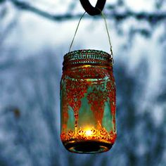 Lanterns -   -1 mason jar  -1 fine point marker  -puffy paint  Draw your design with a marker  trace with puffy paint