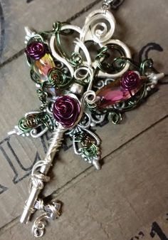 Wire wrapped key with fairy wings!  https://www.etsy.com/shop/LepidusPlasmatio https://www.facebook.com/LepidusPlasmatio