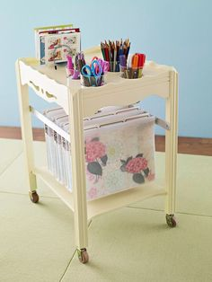 Organize Now- Mobile Home Office: An old table receives a fresh start as an office on wheels.   How to make it: Choose a table the width of a standard hanging file, then sand, prime, and paint it. Screw metal strips to the sides to accommodate hanging files, use a jigsaw to cut holes in the top for glasses or small storage buckets, and attach casters to the legs.