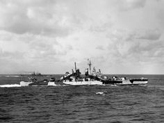 USS WILKES-BARRE steams alongside ASTORIA during a temporary detachment for exercises with other cruisers on the morning of 13 February 1945. In the background is USS BILOXI CL-80. Note that her SK radar is on her mainmast instead of her fore--the only CLEVELAND-class cruiser so configured. -photo taken by and courtesy of Herman Schnipper!