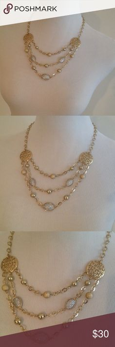 Gold and silver tone multi layered necklace Gold tone multi layered necklace with silver shimmery accents beads. Jewelry Necklaces