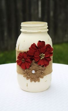 This gorgeous mason jar would be a lovely addition to your home. Use it alone as a cute home accent, or utilize it as a stylish container! This jar is painted in vintage white and is embellished with burlap ribbon and paper flowers. Each jar is painted Mason Jar Projects, Mason Jar Crafts, Mason Jar Diy, Bottle Crafts, Diy Projects, Burlap Mason Jars, Red Mason Jars, Pot Mason, Bottles And Jars