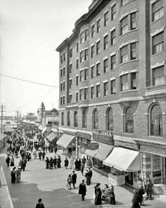 "The Jersey shore circa 1904. ""Young's Hotel and Boardwalk, Atlantic City.""Where strollers confront a plenitude of amusements, confections and refreshments."