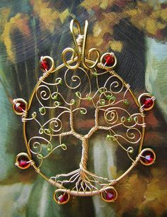 """Eversong Woods"" Inspired by the Blood Elf race from World of Warcraft, this Tree of Life pendant is meant to represent Eversong Woods! With a gold sun-like frame and their signature red crystals (I used Swarovskis), this unique design makes a perfect pendant or ornament for any Blood Elf fan! FOR THE HORDE! Etsy link: https://www.etsy.com/listing/179598332/world-of-warcraft-eversong-woods-blood?ref=shop_home_active_10"