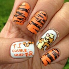 Tigger nails! Now if this isn't motivation for me to grow out my nails i don't know what is.