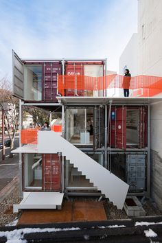 japanese practice daiken-met architects have designed and completed 'sugoroku office', their personal studio  in gifu, japan. a three storey mobile framework supports stacked shipping containers, forming the work areas  and future living spaces on the penthouse floor.