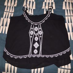 Black blousey tank Black silky tank with white stitching Tops Blouses