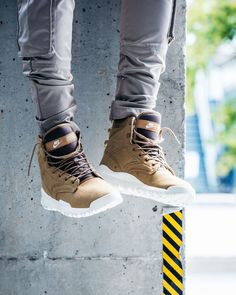 Rugged terrain calls for heavy duty, and this boot delivers just that. The Nike SFB Field Canvas Boot stands 6 inches tall with a crisp white midsole that's traction grips the ground with ease. Find your pair in store or by phone at Epitome.