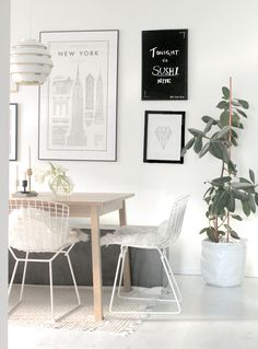 "Artek beehive A331 with Ehrenstråhle ""The Monumental Guide to New York"" poster, White-washed oak table, Bertoia Wire Side chairs  concrete bench in our dining area."