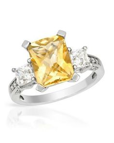 Ring With Citrine - Size 7 Pleasant ring with genuine citrine and cubic zirconia well made in 925 sterling silver. Total item weight 3.3g. Gemstone info: 1 citrine, 3.01ctw., checkerboard shape and yellow color, 16 cubic zirconia, 1.47ctw., multi-shaped and white color.