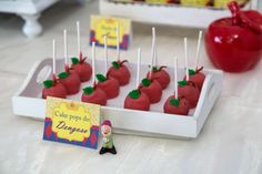Apples cake pops at a Snow White birthday party! See more party planning ideas at CatchMyParty.com!