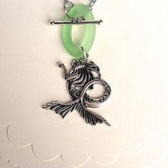 $17.00.  THE LITTLE MERMAID necklace.  Sea glass toggle is sooooo cute.  Love this from my favorite vendor.