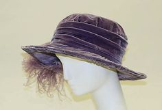 1917 purple hat trimmed with ostrich feather. I really like this one simply elegant, and the color is just perfect.