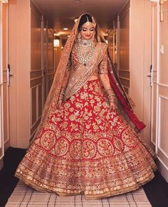 Find the most trending orange-colored bridal lehenga designs of Orange lehengas for this wedding season you cannot afford to miss. Lehenga Wedding, Indian Bridal Lehenga, Desi Wedding, Pakistani Bridal, Wedding Reception, Wedding Wear, Gold Lehenga Bridal, Wedding Gowns, Desi Bride