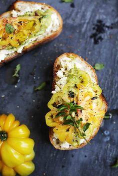 tomato + guacamole crostini