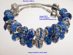 Blue is beautiful!  This large hole Pandora style bead bracelet puts the focus on a lovely bright almost royal blue color.  The center accent bead is covered with small Chinese crystals forming a ring of blue flanked by clear crystals.  Extending out from the center, blue faceted round bead with a slight iridescent finish is repeated further from the center.  The dark blue crystals bead help form the central group.  $31.95