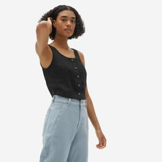 An update on a classic. Made of naturally cool linen, the Linen Button-Front Crop Tank features a flattering scoop neck, bra-friendly straps, a clean button front, and a modern cropped length. Pair it with the matching Linen Button-Front Skirt for a head-turning take on a two-piece set.