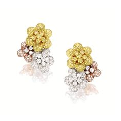 PAIR OF COLOURED DIAMOND AND DIAMOND EAR CLIPS Each designed as cluster of three flowers, set with diamonds and coloured diamonds altogether weighing approximately 4.60 carats, with clip and post fittings, mounted in 18 karat white, yellow and pink gold.